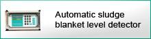 Automatic sludge level detector